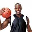 Happy male basketball player holding the ball against white - Stock Photo