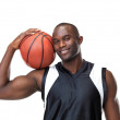 Royalty-Free Stock Photo: Young man posing with basketball against white