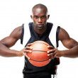 Royalty-Free Stock Photo: Young basketball player gripping the ball tight