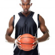 Professional basketball player standing with a ball in hand - Stockfoto
