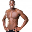Royalty-Free Stock Photo: Happy bodybuilder with muscular physique posing against white