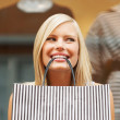 Pretty girl with shopping bag - Stock Photo