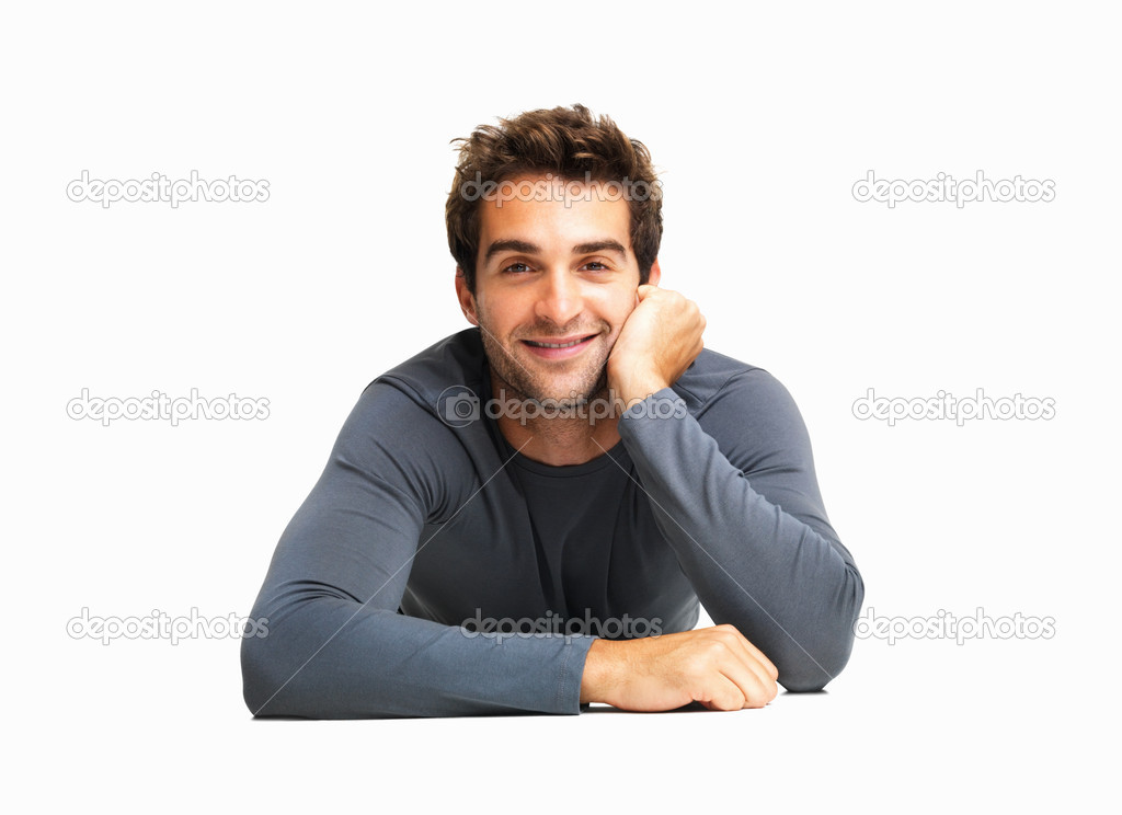 Attentive man lying on the floor listening — Stock Photo #7758891