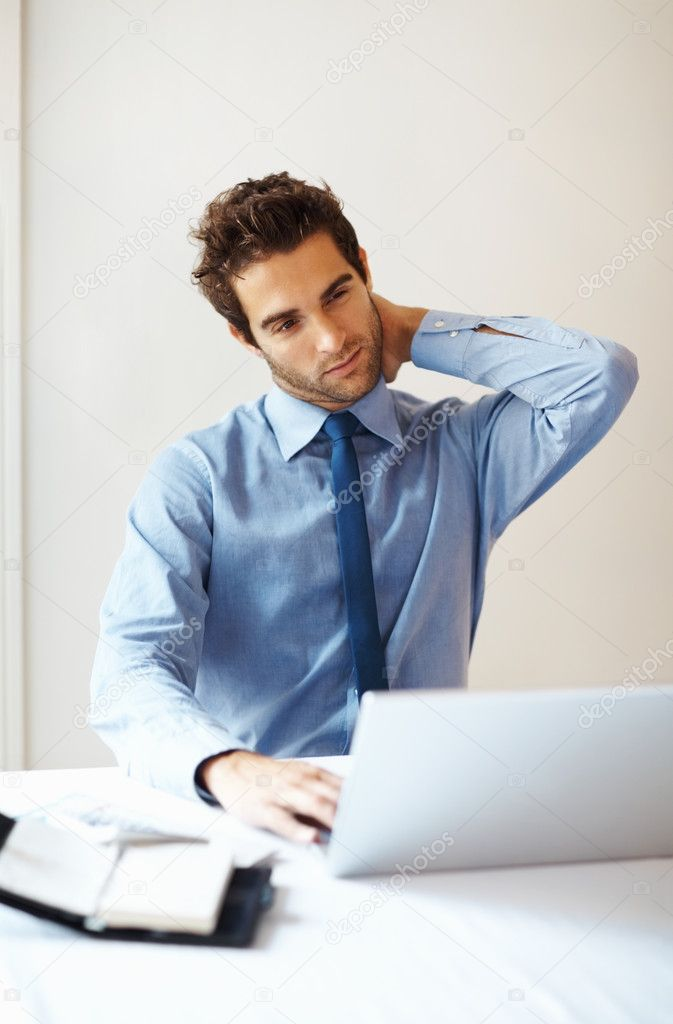 Young business man suffering from neck pain — Stock Photo #7759121