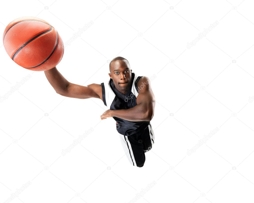 Portrait of a young male basketball player jumping in air trying to dunk the ball — Stock Photo #7759593
