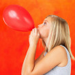 Blowing balloon - Stock fotografie