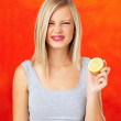 Royalty-Free Stock Photo: Pretty woman holding a sour lemon