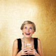 Beautiful woman holding champagne glass - Stock Photo
