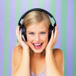 Pretty woman listening to music - Stock Photo