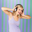 Pretty woman singing along with music - Photo