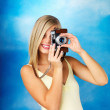 Royalty-Free Stock Photo: Woman using vintage camera