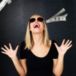 Royalty-Free Stock Photo: Woman with sunglasses excited that money is falling