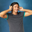 Flirtatious man with headphones on - Stockfoto