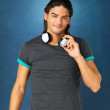 Happy man with headphones - Stockfoto