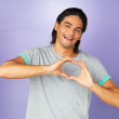 Royalty-Free Stock Photo: Happy man making heart sign over heart