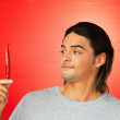 Man holding red chili pepper - Stockfoto