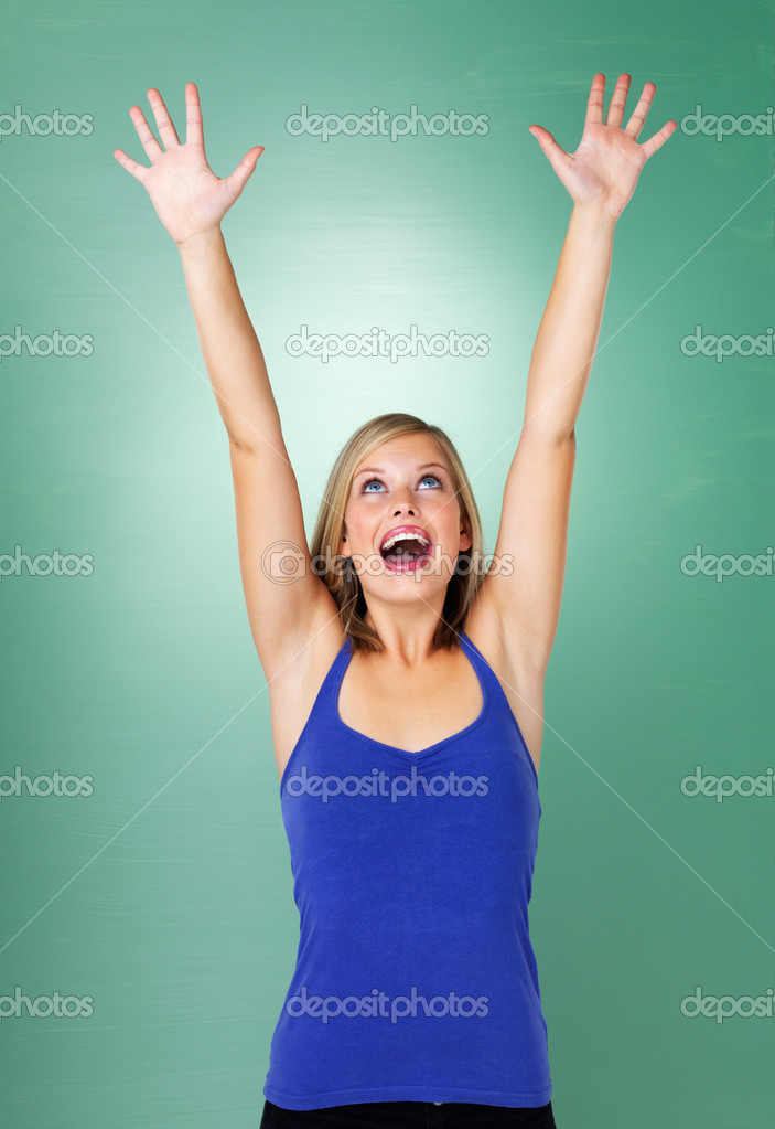 Woman holding arms up in excitement — Stock Photo #7761151