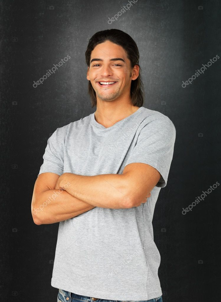 Handsome man dressed casually with arms folded against gray background — Stock Photo #7762711