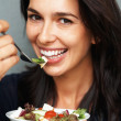 Happy woman holding salad - Photo