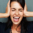 Woman yelling in frustration - Stock Photo