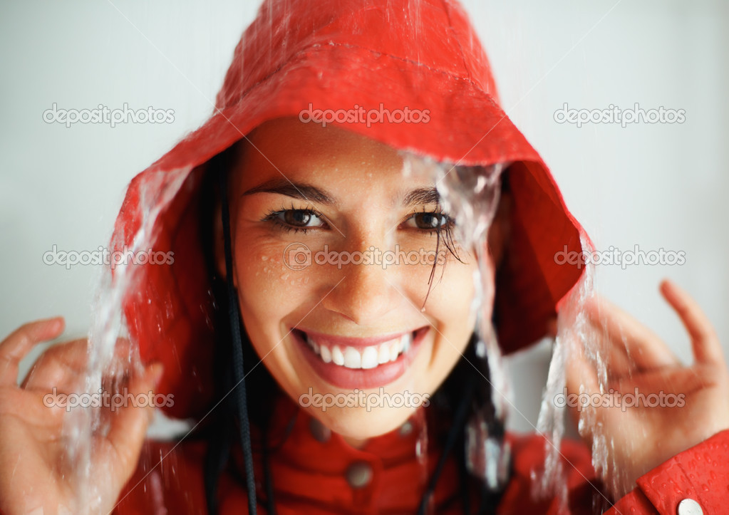 Closeup of woman getting rained on indoors  Stock Photo #7779573