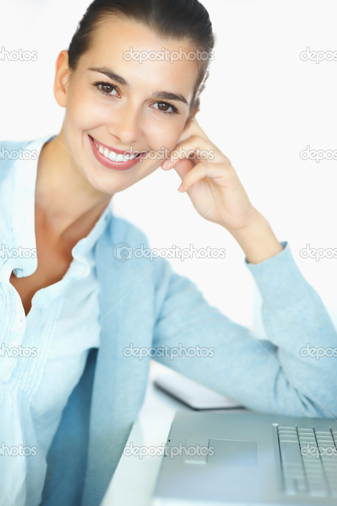 Happy woman sitting in front of laptop — Stock Photo #7779603