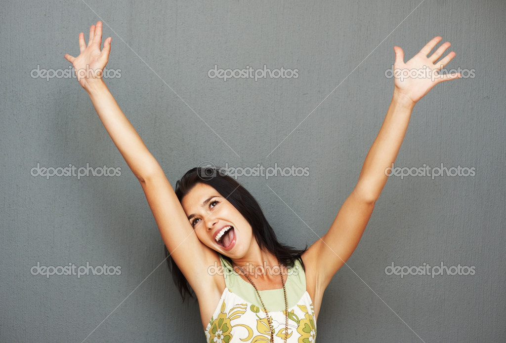 Pretty woman holding arms up in air in excitement — Stock Photo #7779714