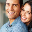 Cute couple smiling together - Stock Photo