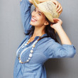 Woman posing with hat - Stock Photo