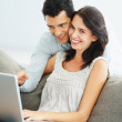 Couple with laptop - Stock Photo