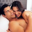 Royalty-Free Stock Photo: Couple cuddling in bed
