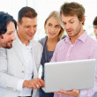 Royalty-Free Stock Photo: Team leader showing colleagues proposal on laptop
