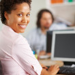 Young woman working from office - Stockfoto