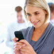 Royalty-Free Stock Photo: Woman text messaging