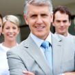 Royalty-Free Stock Photo: Leadership - Team of business colleagues standing together