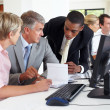 Business meeting - Diverse business group during a discussion - Stock Photo