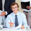 Royalty-Free Stock Photo: Confident young businessman signing a contract