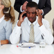 Royalty-Free Stock Photo: Afroamerican businessman suffering from headache during a meetin