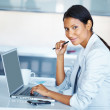 Business woman hard at work - Stock Photo