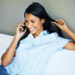 Happy woman having phone conversation - Stock Photo