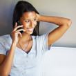 Happy woman talking on the phone - Stock Photo