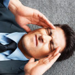 Executive fighting a headache - Stockfoto