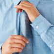 Royalty-Free Stock Photo: Executive getting dressed