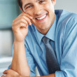 Royalty-Free Stock Photo: Friendly executive sitting and smiling