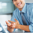 Royalty-Free Stock Photo: Happy executive at desk
