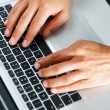 Royalty-Free Stock Photo: Male hands typing on laptop computer