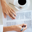 Royalty-Free Stock Photo: Woman hand signing on document with coffee