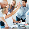 Excited businesspeople giving each other high five for successfu - Stok fotoğraf