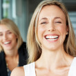 Young businesswoman laughing with her colleague at back - Stock Photo