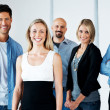Business team - Young attractive businesspeople standing - Stock Photo